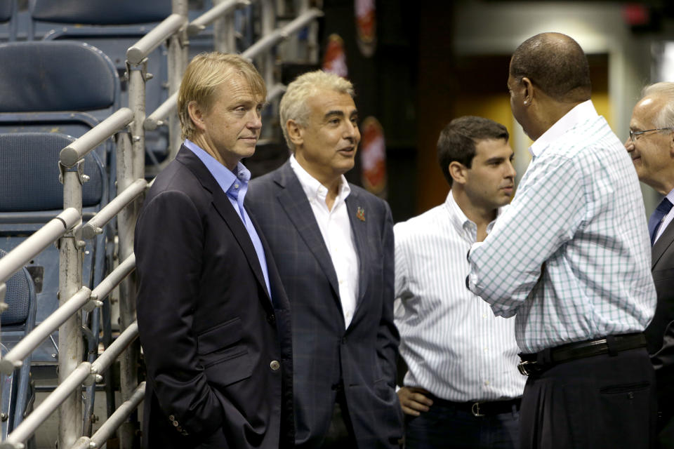 MILWAUKEE, WI - JULY 2: (L-R) Owners Wesley Edens (L) & Marc Lasry (2L) await for the official announcement of their new head coach Jason Kidd to the Milwaukee Bucks at BMO Harris Bradley Center on July 2, 2014 in Milwaukee, Wisconsin. NOTE TO USER: User expressly acknowledges and agrees that, by downloading and or using this photograph, User is consenting to the terms and conditions of the Getty Images License Agreement. (Photo by Mike McGinnis/Getty Images)