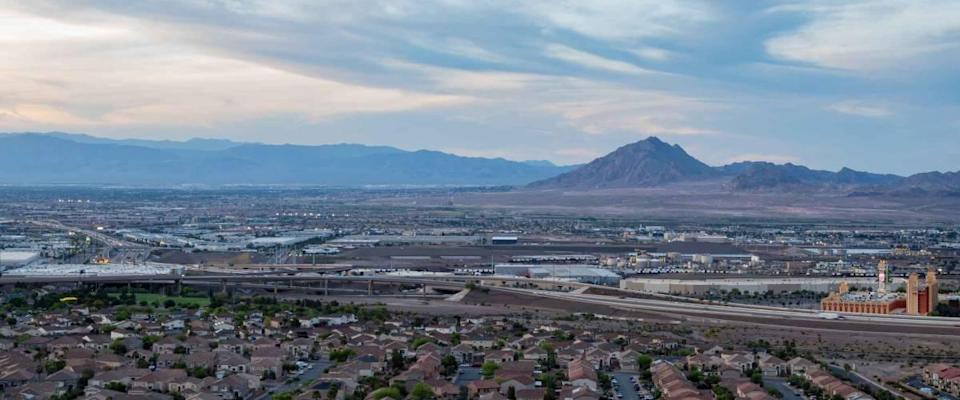Sunset high angle view of the Frenchman Mountain and cityscape from Henderson View Pass at Nevada