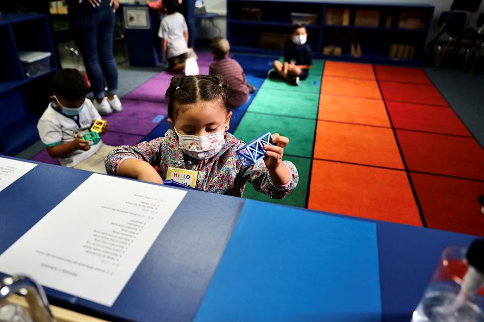 Kindergarten children play toys in a classroom at Montrara Ave. Elementary School in Los Angeles, California, the United States, on Aug. 16, 2021. Hundreds of thousands of Los Angeles Unified School District students returned to classrooms on Monday. Mask-wearing will be required by students and staff, and regular cleaning and sanitizing will be conducted on campuses, with frequent hand-washing and social distancing encouraged. (Photo by Xinhua via Getty Images)