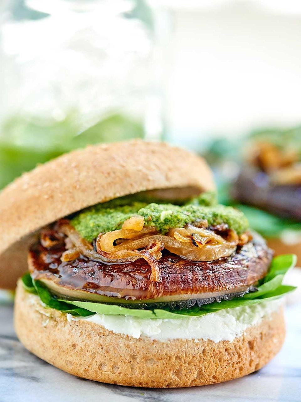 "<p>Topped with caramelized onions, homemade basil pesto, and goat cheese, these portobello mushroom burgers have all the best flavors packed into one. The rich pesto and creamy goat cheese are sure to make you swoon.</p> <p><strong>Get the recipe</strong>: <a href=""https://showmetheyummy.com/portobello-mushroom-burger/"" class=""link rapid-noclick-resp"" rel=""nofollow noopener"" target=""_blank"" data-ylk=""slk:portobello mushroom burger"">portobello mushroom burger</a></p>"