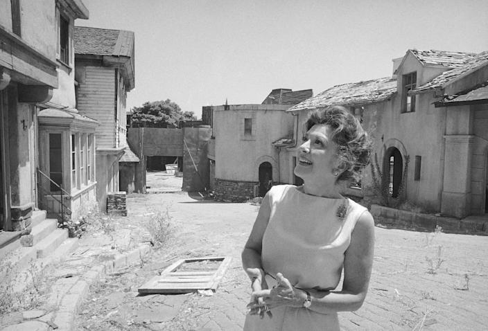 "FILE - This July 26, 1972 file photo shows actress Ann Rutherford gazing at old sets on the MGM studio's Lot 2 in Los Angeles where she and Mickey Rooney filmed the Andy Hardy series. Rutherford, who played Scarlett O'Hara's sister Carreen in the 1939 movie classic ""Gone With the Wind,"" died at her home in Beverly Hills, Calif. on Monday, June 11, 2012. She was 94. (AP Photo/JLR, file)"