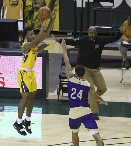Baylor guard L.J. Cryer (4) attempts a three point shots over Alcorn State guard Arne Morris (24) in the first half of an NCAA college basketball game, Wednesday, Dec. 30, 2020, in Waco, Texas. (AP Photo/ Jerry Larson)