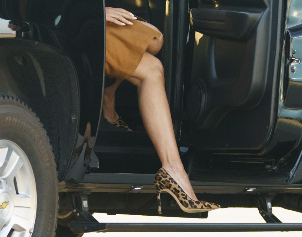 The first lady wore leopard-print Manolo Blahniks for the journey. (Photo: Carolyn Kaster/AP)