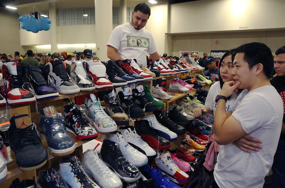 FT LAUDERDALE, FLORIDA - FEBRUARY 02: Shoppers inspect sneakers on sale by Texas Shoe Exchange during SneakerCon 2019 at Fort Lauderdale Convention Center on February 2, 2019 in Fort Lauderdale, Florida.  (Photo by Sean Drakes/Getty Images)