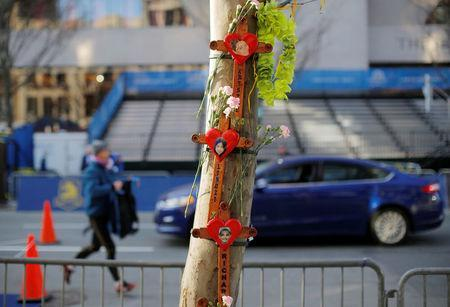 Memorials for the Boston Marathon bombing victims hang on a tree at the site of the first bomb blast. REUTERS/Brian Snyder