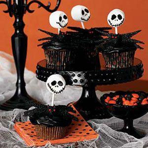 """<p>With some marshmallows and a little black frosting, you make make a surprisingly faithful rendition of a certain king of Halloween Town.</p><p><strong><a href=""""https://www.countryliving.com/food-drinks/recipes/a30551/skeleton-cupcakes-121387/"""" rel=""""nofollow noopener"""" target=""""_blank"""" data-ylk=""""slk:Get the recipe"""" class=""""link rapid-noclick-resp"""">Get the recipe</a>.</strong></p>"""