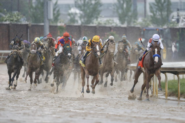 Mike Smith, right, rides Justify through the fourth turn and unto victory during the 144th running of the Kentucky Derby horse race at Churchill Downs Saturday, May 5, 2018, in Louisville, Ky. (AP)