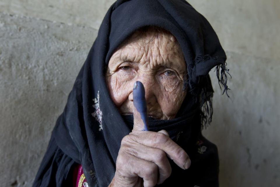 "<div class=""inline-image__caption""><p>An elderly Afghan woman shows off her inked finger to the camera after she made it to the polls to cast her vote September 18, 2010 in Kabul, Panjshir, Afghanistan. More than 2,500 candidates will contest for 249 seats in the lower house of the Afghan parliament in the country's second election.The Taliban warned voters to boycott the polls threatening violence to disturb the election process. </p></div> <div class=""inline-image__credit"">Paula Bronstein/Getty</div>"