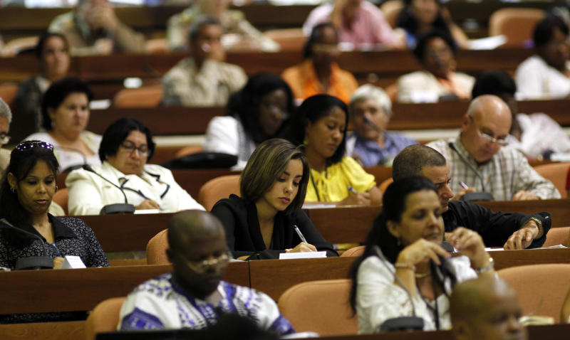 Members of Cuba's National Assembly work during the second day of a twice-annual legislative sessions, at the National Assembly in Havana, Cuba, Sunday, July 7, 2013. Observers will be watching to see if the new vice president is taking on increasing responsibility since assuming the post in what was seen as the beginning of a generational leadership transition. (AP Photo/Ismael Francisco, Cubadebate)