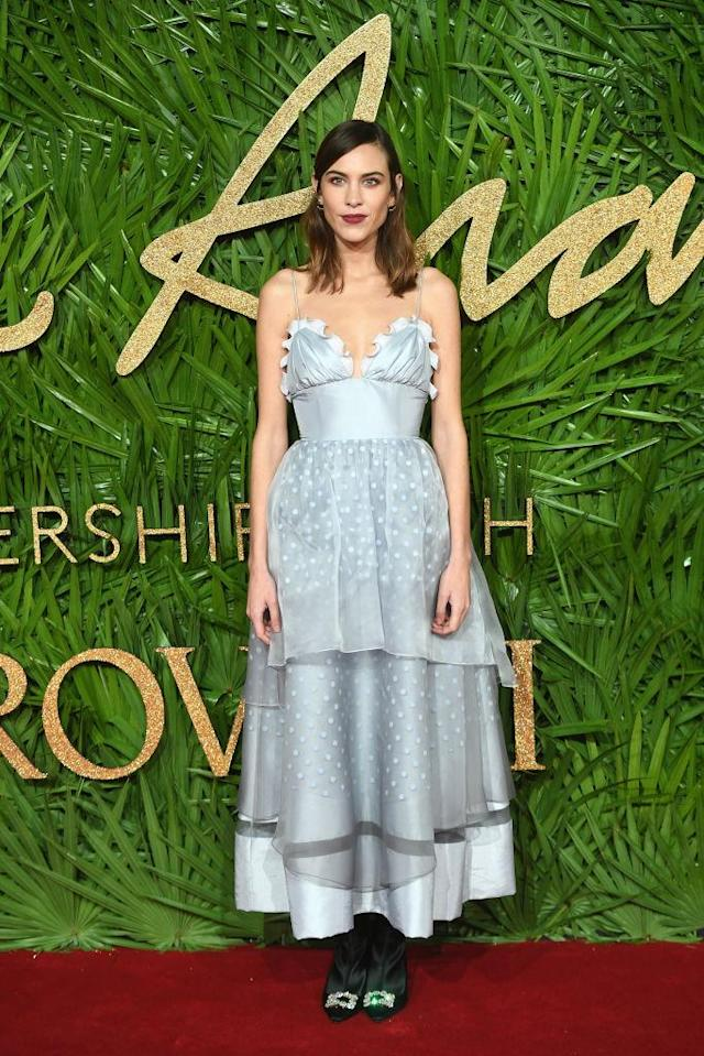 <p>Alexa Chung looked prim in a powder blue dress from her own label. She finished the look with a berry-hued lip and forest green shoes. (Photo: Getty Images) </p>