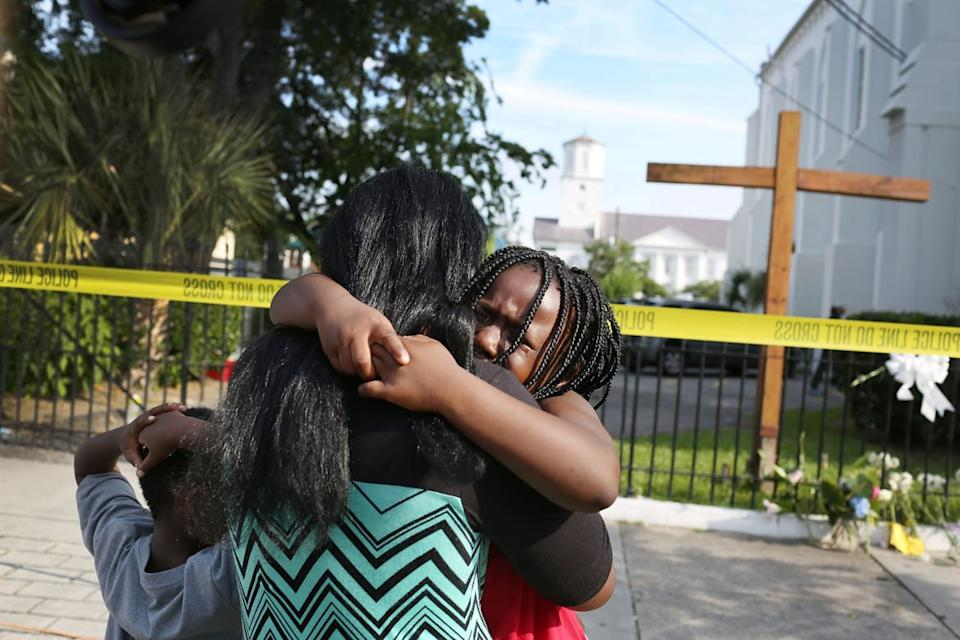 "<div class=""inline-image__caption""><p>\Kearston Farr comforts her daughter, Taliyah Farr,5, as they stand in front of the Emanuel African Methodist Episcopal Church after a mass shooting at the church that killed nine people of June 19, 2015. A 21-year-old white gunman is suspected of killing nine people during a prayer meeting in the church, which is one of the nation's oldest black churches in Charleston.</p></div> <div class=""inline-image__credit"">Joe Raedle/Getty</div>"