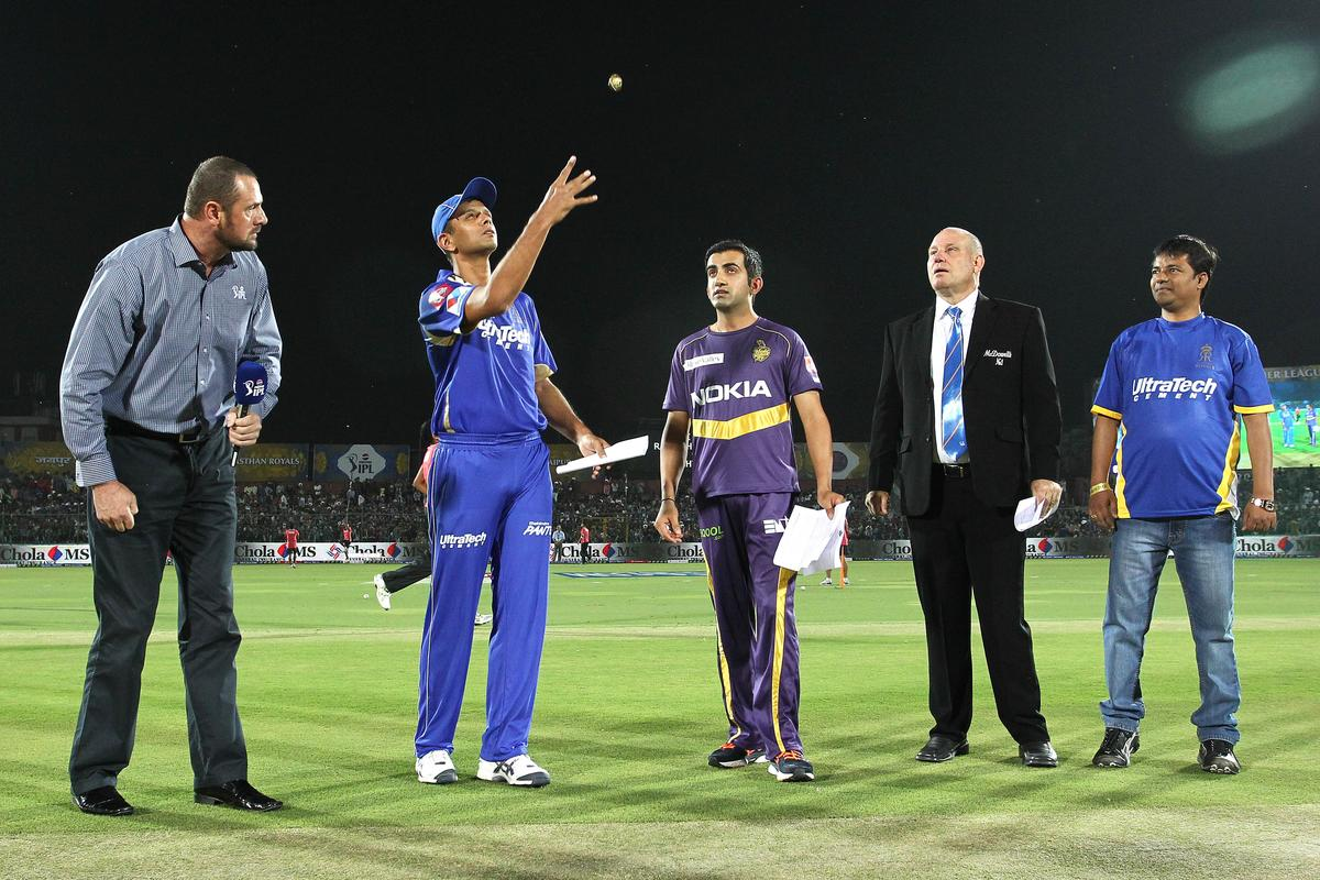 Rajasthan Royals captain Rahul Dravid tosses the coin as Kolkata Knight Riders captain Gautam Gambhir calls during match 8 of the the Pepsi Indian Premier League ( IPL) 2013 between The Rajasthan Royals and the Kolkata Knight Riders held at the Sawai Mansingh Stadium in Jaipur on the 8th April 2013..Photo by Shaun Roy-IPL-SPORTZPICS..Use of this image is subject to the terms and conditions as outlined by the BCCI. These terms can be found by following this link:..https://ec.yimg.com/ec?url=http%3a%2f%2fwww.sportzpics.co.za%2fimage%2fI0000SoRagM2cIEc&t=1498727209&sig=qJ9365MqfVVgSJZpKn4cWQ--~C