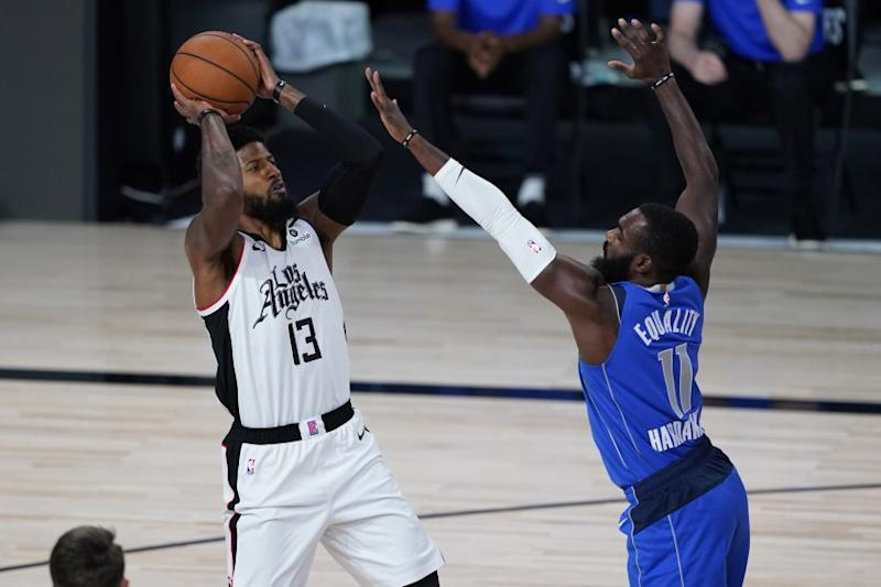 Dallas Mavericks' Tim Hardaway Jr. covers Clippers' Paul George.