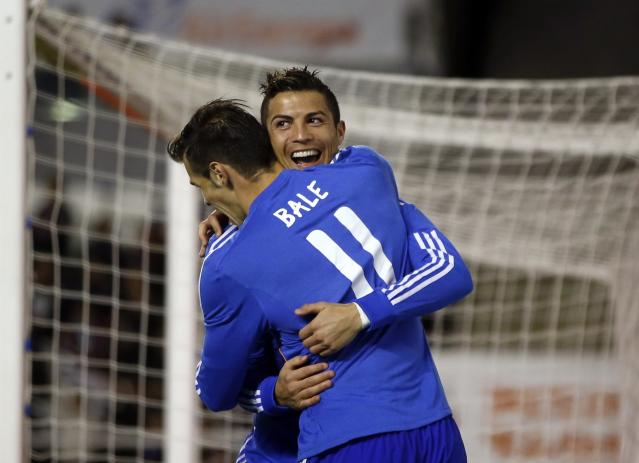 REFILE - CORRECTING IDENTITY OF GOAL SCORER Real Madrid's Cristiano Ronaldo celebrates scoring against Rayo Vallecano with teammate Gareth Bale (L) during their Spanish first division soccer match at Vallecas stadium in Madrid November 2, 2013. REUTERS/Susana Vera (SPAIN - Tags: SPORT SOCCER)