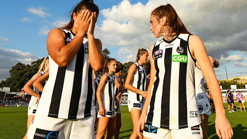 Collingwood players, pictured here after a loss in the AFLW.