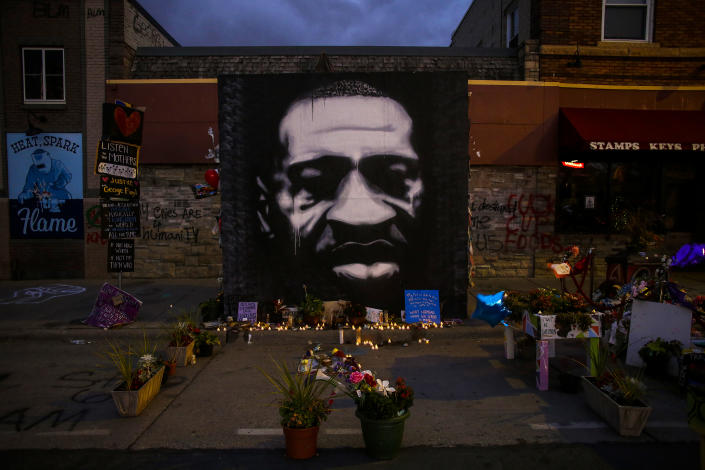 MINNEAPOLIS, MN - OCTOBER 14: Flameless candles are illuminated after being placed at the memorial for George Floyd outside Cup Foods to celebrate what would have been Floyd's 47th birthday on October 14, 2020 in Minneapolis, Minnesota. Floyd, who grew up in the Cuney Homes complex in Houston, Texas' Third Ward was killed May 25 after being arrested outside of Cup Foods convenience store in Minneapolis for allegedly using counterfeit money. Four Minneapolis police officers were fired after a video taken by a witness was posted on social media showing Floyd's neck pinned to the ground for over 8 minutes by former officer Derek Chauvin's knee during the arrest. Floyd was pronounced dead after being transported to Hennepin County Medical Center and former officer Chauvin was later charged with his murder.(Photo by Joshua Lott/The Washington Post via Getty Images)