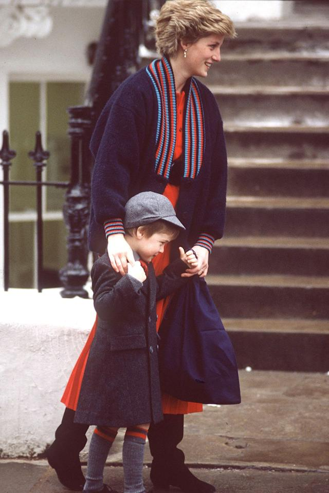 """<p>Two years later, William is spotted en route to his first day at the exclusive Wetherby School. A classically chic <a href=""""https://www.marieclaire.com/celebrity/g19468597/meghan-markle-channels-princess-diana/"""" target=""""_blank"""">Princess Diana</a> nudges the little guy along. </p>"""