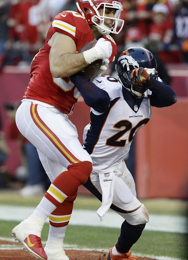 Kansas City Chiefs tight end Anthony Fasano (80) makes a touch-down reception against Denver Broncos strong safety Mike Adams (20) during the first half of an NFL football game, Sunday, Dec. 1, 2013, in Kansas City, Mo. (AP Photo/Charlie Riedel)