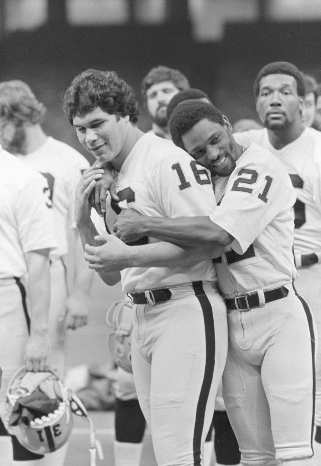 FILE - In this Jan. 21, 1981, file photo Oakland Raiders wide receiver Cliff Branch (21) hugs quarterback Jim Plunkett (16) as the Raiders lined up for a team picture before a workout in the Superdome in New Orleans. Branch, one of the Raiders career-leading receivers who won three Super Bowls, has died. He was 71. (AP Photo/Paul Sakuma, File)