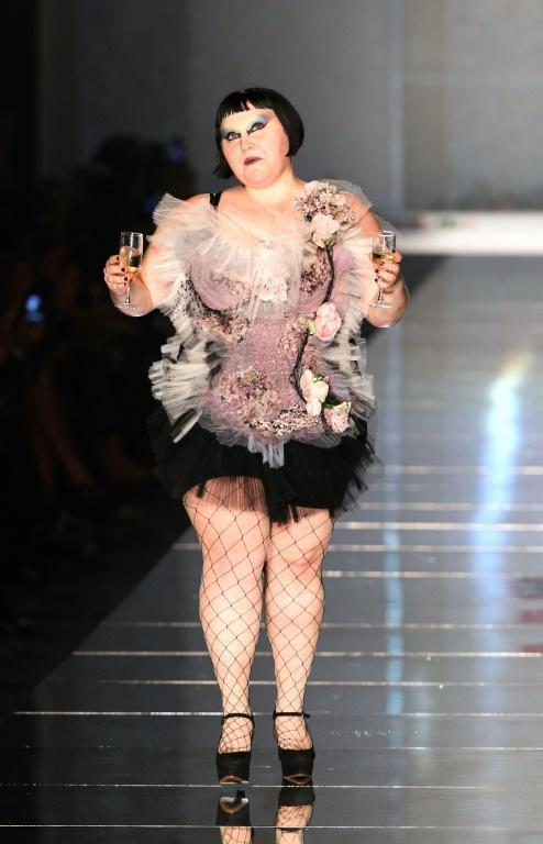 American singer Beth Ditto was among the atypical models whom Gaultier charmed into his party-like shows (AFP Photo/PIERRE VERDY)