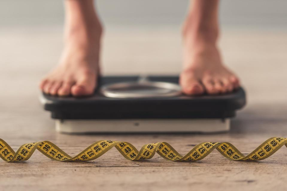 New research has revealed we gain more weight when we eat while we're stressed [Photo: Getty]