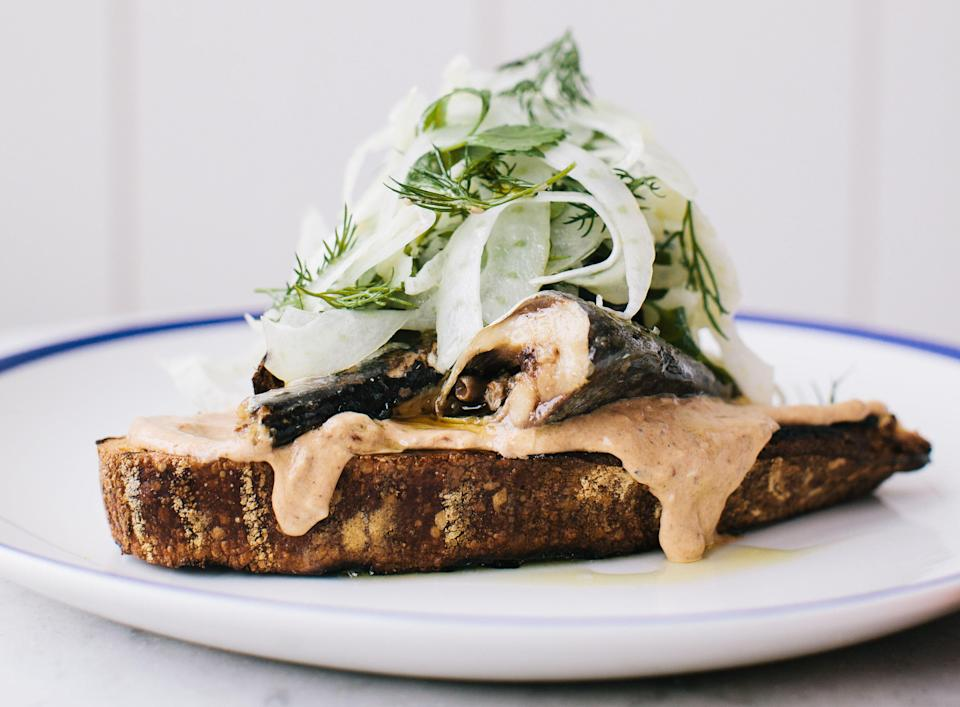 """Chef Erickson has access to the best seafood anywhere; when it comes to sardines, she goes with Matiz sardines in olive oil. <a href=""""https://www.bonappetit.com/recipe/sardine-toasts-with-tomato-mayonnaise-and-fennel?mbid=synd_yahoo_rss"""" rel=""""nofollow noopener"""" target=""""_blank"""" data-ylk=""""slk:See recipe."""" class=""""link rapid-noclick-resp"""">See recipe.</a>"""