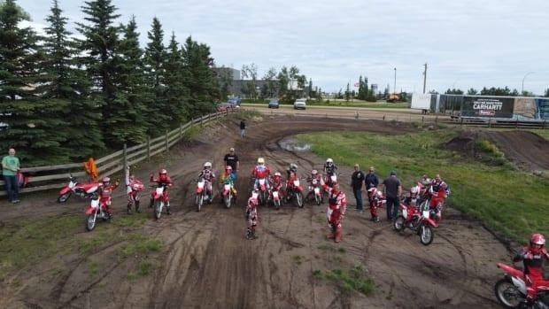Some youngsters hit the dirt for a lesson with Jason Schrage, who runs Alberta Rides, a program that introduces kids to dirt biking.