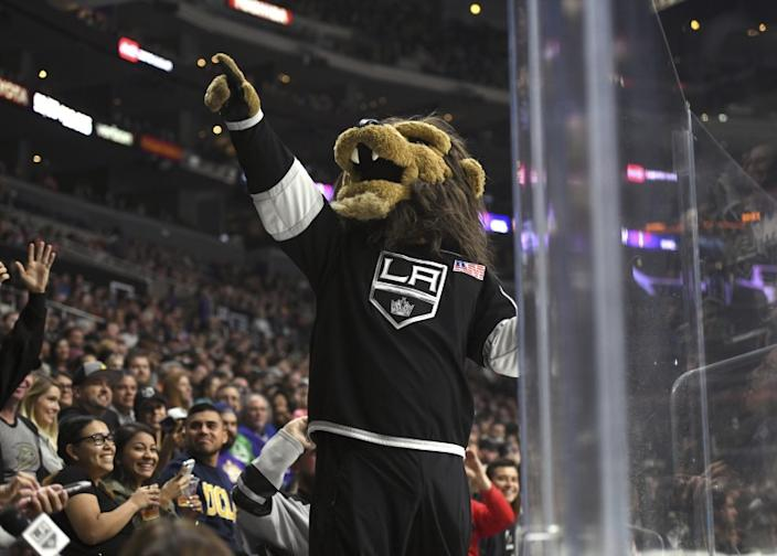 Los Angeles Kings mascot Bailey entertains the crowd during a preseason NHL hockey game against the Anaheim Ducks, Saturday, Sept. 30, 2017, in Los Angeles. (AP Photo/Michael Owen Baker)