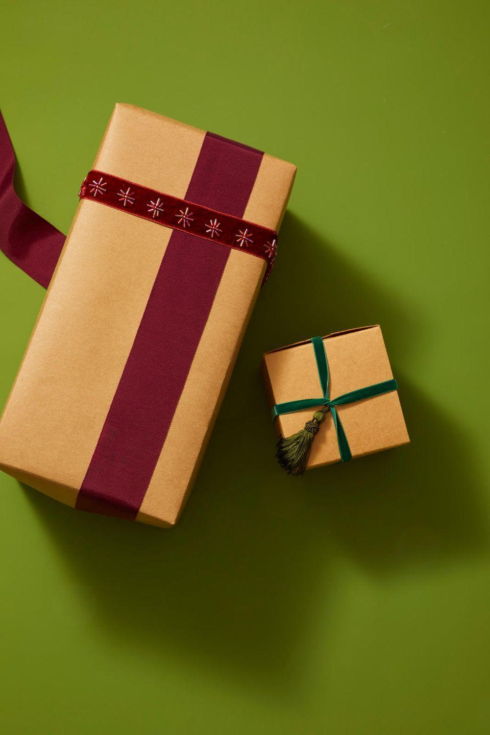 """<p>If you have leftover ribbon or scraps of trim, don't throw them away! Layer them on top of each other to add a little extra something to your gift.</p><p><strong>RELATED: </strong><a href=""""https://www.goodhousekeeping.com/holidays/christmas-ideas/g29148339/best-christmas-gift-tags/"""" rel=""""nofollow noopener"""" target=""""_blank"""" data-ylk=""""slk:Christmas Gift Tags for the Perfect Finishing Touch"""" class=""""link rapid-noclick-resp"""">Christmas Gift Tags for the Perfect Finishing Touch</a></p>"""