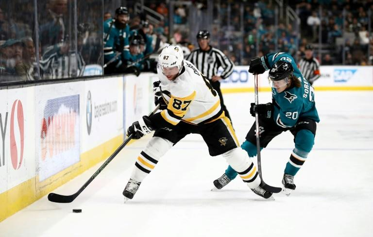 Pittsburgh Penguins superstar Sidney Crosby, left, says it is heartwarming to see people following the advice of medical experts by self isolating in their homes during the coronavirus epidemic