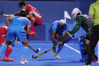 India's Simranjeet Singh (10) attempts a shot against Japan during a men's field hockey match at the 2020 Summer Olympics, Friday, July 30, 2021, in Tokyo, Japan. (AP Photo/John Locher)