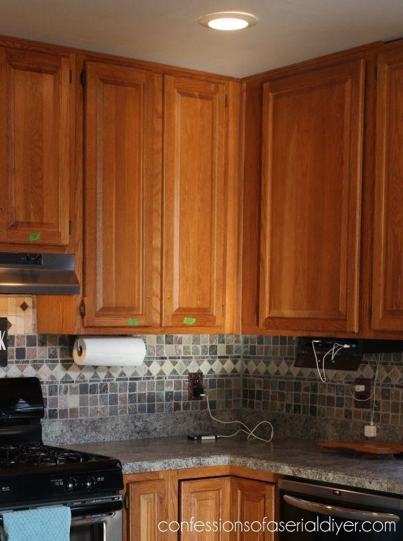 <p>Or, you could always add a glass panel to cabinet doors to open up your cabinets, as this blogger did.</p>
