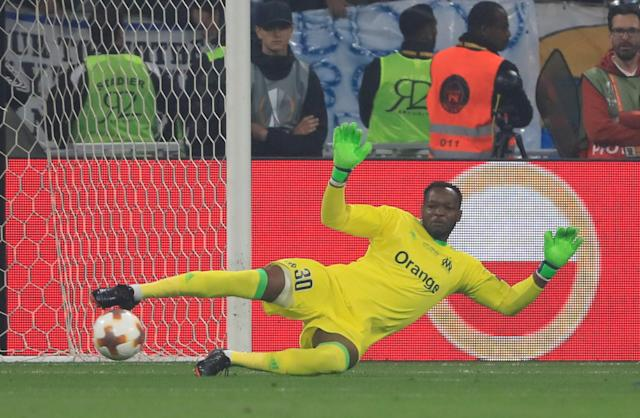 Soccer Football - Europa League Final - Olympique de Marseille vs Atletico Madrid - Groupama Stadium, Lyon, France - May 16, 2018 Marseille's Steve Mandanda concedes their first goal scored by Atletico Madrid's Antoine Griezmann (not pictured) REUTERS/Gonzalo Fuentes
