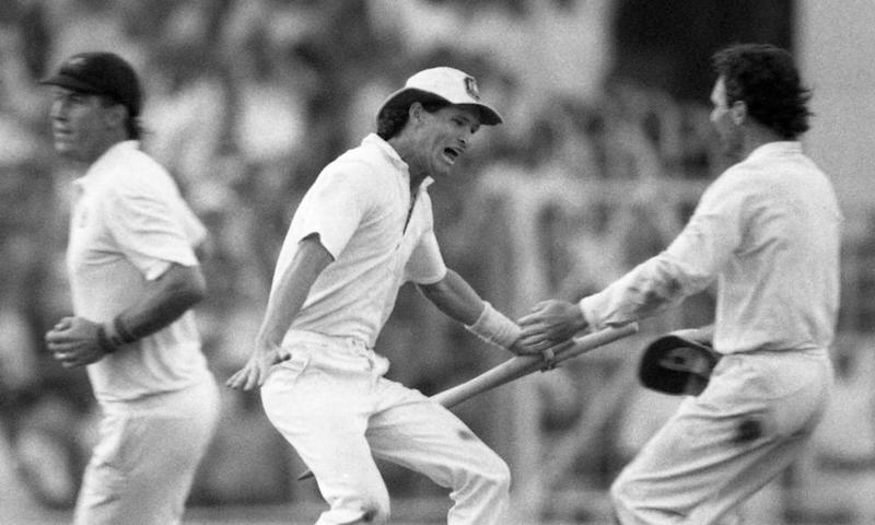 Dean Jones holds a stump as he races to embrace his captain, Allan Border, after Australia beat England in 1987 World Cup final.