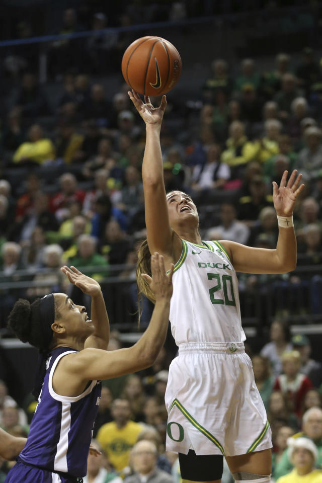 Oregon's Sabrina Ionescu, right, shots over Kansas State's Angela Harris during the second quarter of an NCAA college basketball game in Eugene, Ore., Saturday, Dec. 21, 2019. (AP Photo/Chris Pietsch)