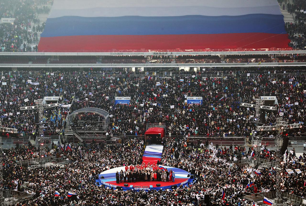 <p>People rally in support of Russia's incumbent President Vladimir Putin at the Luzhniki Stadium ahead of the 2018 Russian presidential election scheduled for March 18. (Photo: Stanislav Krasilnikov/TASS via Getty Images) </p>