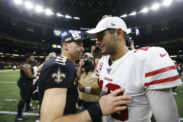 New Orleans Saints quarterback Drew Brees (9) greets San Francisco 49ers quarterback Jimmy Garoppolo (10) after an NFL football game in New Orleans, Sunday, Dec. 8, 2019. The 49ers won 48-46. (AP Photo/Butch Dill)