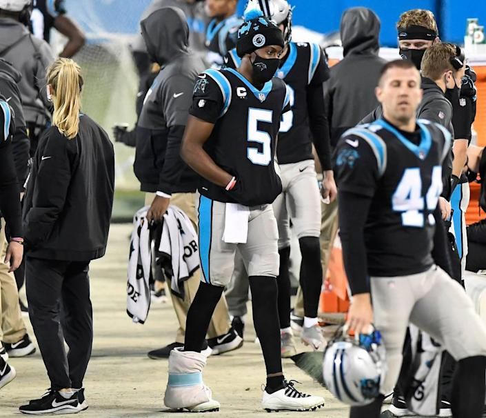 Carolina Panthers Teddy Bridgewater (5) walks with his right foot wrapped along the sideline during the fourth quarter against the New Orleans Saints Sunday. Bridgewater was benched in the third quarter in Carolina's 33-7 loss.