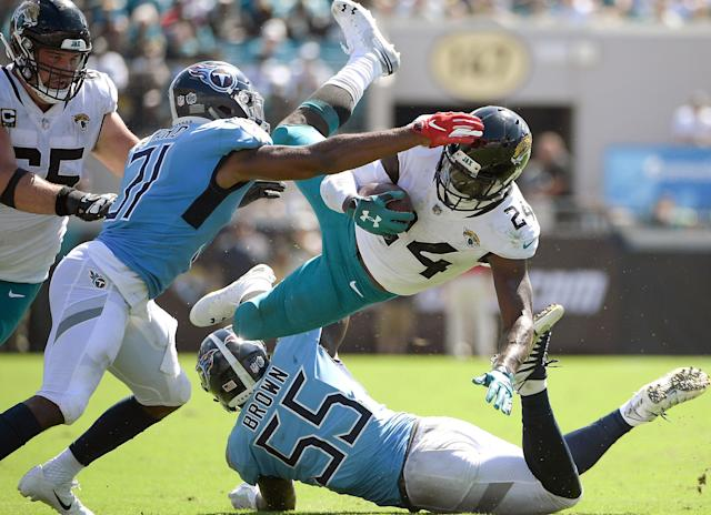 <p>Jacksonville Jaguars running back T.J. Yeldon (24) is upended by Tennessee Titans linebacker Jayon Brown (55) during the second half of an NFL football game, Sunday, Sept. 23, 2018, in Jacksonville, Fla. (AP Photo/Phelan M. Ebenhack) </p>