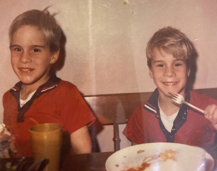 In this undated photo from the 1960s, Billy and Bobby Ford smile during a meal.