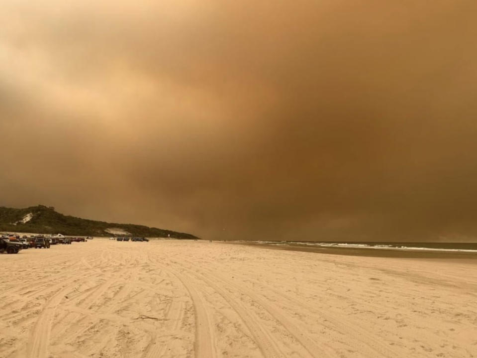 Fraser Island beach is surrounded by thick smoke from nearby bushfires.