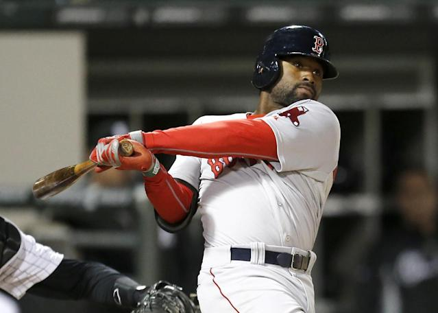 Boston Red Sox's Jackie Bradley Jr. hits a two-run double off Chicago White Sox second baseman Leury Garcia, who was pitching in relief, during the 14th inning of a baseball game Thursday, April 17, 2014, in Chicago. Daniel Nava and Jonathan Herrera scored on the play. (AP Photo/Charles Rex Arbogast)