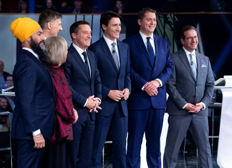 Canadian voters will choose between party leaders, pictured here on October 10