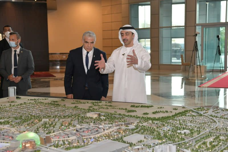 Israeli Foreign Minister Yair Lapid stands next to UAE Foreign Minister Sheikh Abdullah bin Zayed al-Nahyan during their meeting in Abu Dhabi, United Arab Emirates