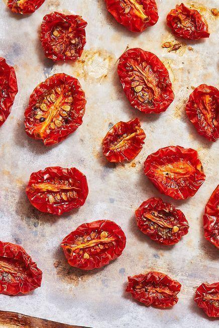 """<p>We LOVE having these flavourful sun-dried tomatoes on hand. Stir them into your <a href=""""https://www.delish.com/uk/cooking/recipes/a29099239/best-homemade-fettuccine-alfredo-recipe/"""" rel=""""nofollow noopener"""" target=""""_blank"""" data-ylk=""""slk:fettuccine alfredo"""" class=""""link rapid-noclick-resp"""">fettuccine alfredo</a>, slice them and add them to your <a href=""""https://www.delish.com/uk/cooking/recipes/a29260396/chicken-caesar-pasta-salad-recipe/"""" rel=""""nofollow noopener"""" target=""""_blank"""" data-ylk=""""slk:caesar salad"""" class=""""link rapid-noclick-resp"""">caesar salad</a>, or just snack on 'em plain!</p><p>Get the <a href=""""http://www.delish.com/uk/cooking/recipes/a33070295/sun-dried-tomatoes-recipe/"""" rel=""""nofollow noopener"""" target=""""_blank"""" data-ylk=""""slk:Sun-Dried Tomatoes"""" class=""""link rapid-noclick-resp"""">Sun-Dried Tomatoes</a> recipe.</p>"""