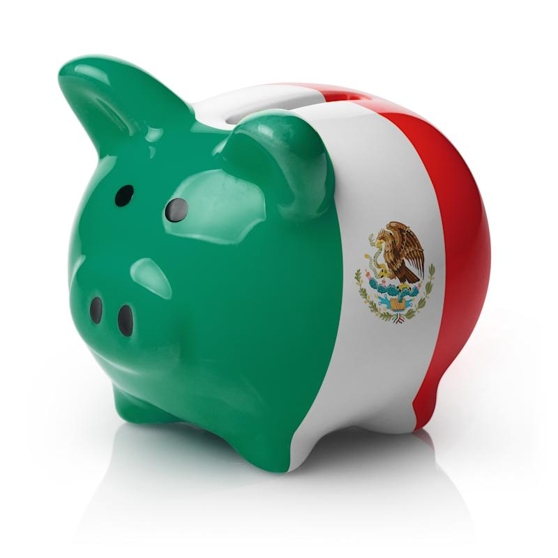 Piggy bank painted in the flag of Mexico