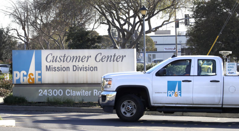 FILE -- In this Wednesday, Jan. 23, 2019, file photo, a Pacific Gas & Electric truck enters their customer center in Hayward, Calif. Gov. Gavin Newsom says PG&E plans to remake its board of directors with hedge fund financiers and people who have little experience in utility operations and safety. Newsom, on Thursday March 28, 2019, said putting hedge fund managers in charge of the company will send a message the utility prioritizes profits over providing safe and reliable energy service. The utility did not immediately comment. (AP Photo/Ben Margot, File)