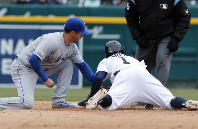 Detroit Tigers' Josh Harrison (1) safely beats the tag of Kansas City Royals second baseman Whit Merrifield during the fifth inning of a baseball game, Thursday, April 4, 2019, in Detroit. (AP Photo/Carlos Osorio)