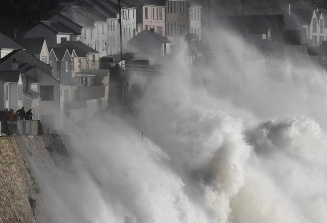 <p>Large waves crash along sea defenses and the harbor as storm Ophelia approaches Porthleven in Cornwall, south west Britain, Oct. 16, 2017. (Photo: Toby Melville/Reuters) </p>