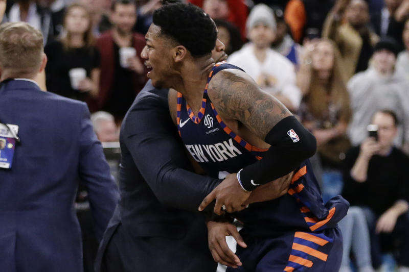 New York Knicks' Elfrid Payton (6) is restrained during the second half of the team's NBA basketball game against the Memphis Grizzlies on Wednesday, Jan. 29, 2020, in New York. Payton was ejected. The Grizzlies won 127-106. (AP Photo/Frank Franklin II)